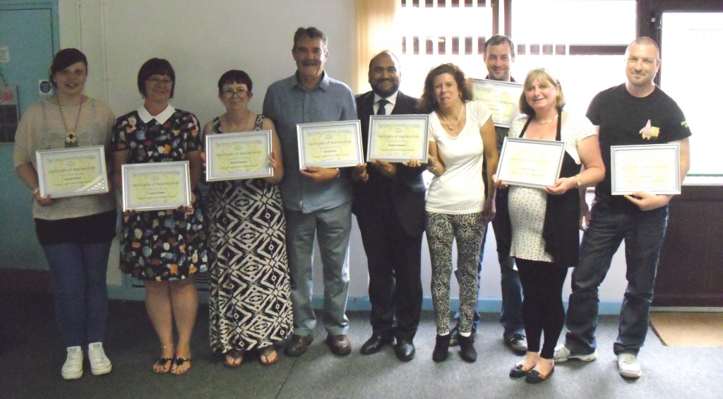 CCA Volunteers receiving their Certificates of Appreciation with the Chairman